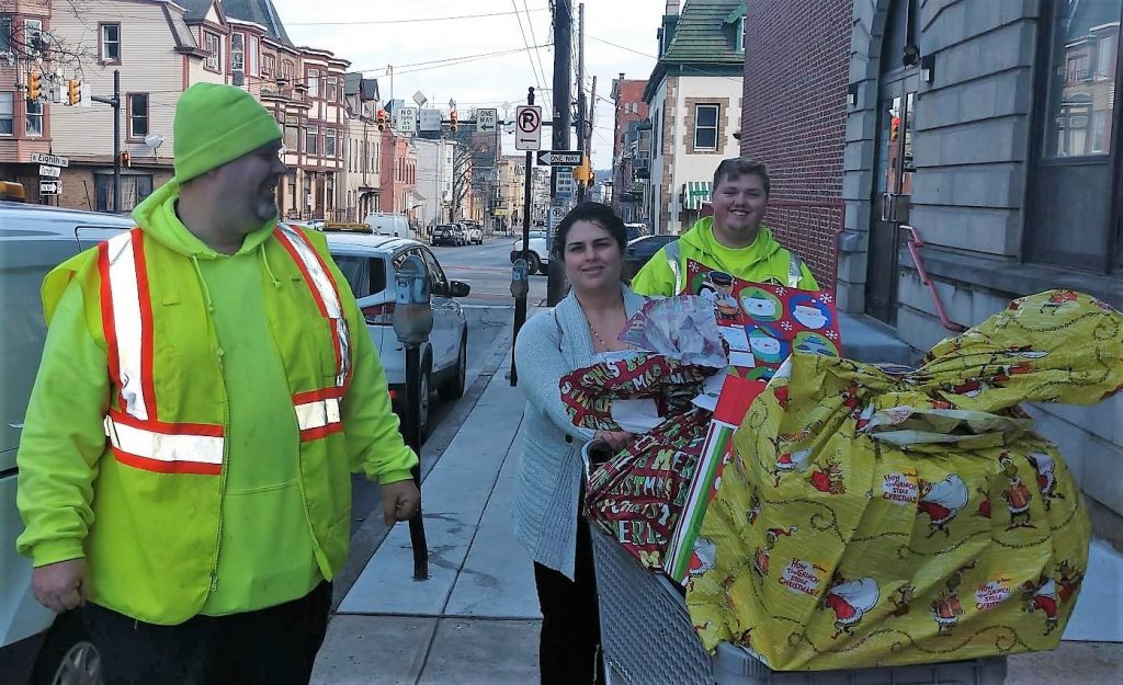 A picture of three LCA employees delivering gifts for children through he Lehigh Valley branch of the Salvation Army.